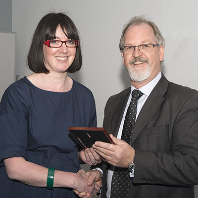 Dr Byrne recieves her award fro Prof Mike Morgan, acting Head of School