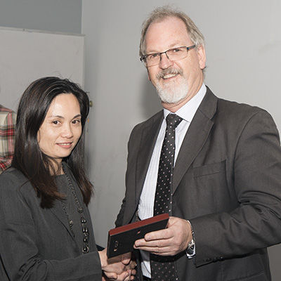 Dr Wong recieves her award fro Prof Mike Morgan, acting Head of School