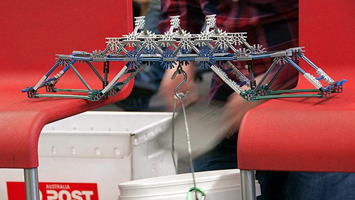 Bridge across 2 chairs, suspending weights