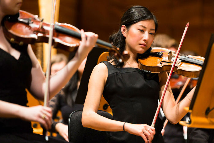 Violinist plays in the University of Melbourne Symphony Orchestra in 2017.