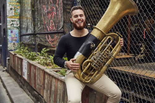 Brass student in a Melbourne laneway. Photo: John O'Rourke, 2017