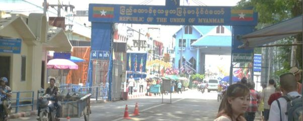 The Thai-Myanmar border crossing, with the Immigration and Tourism office (the yellow building to the left)