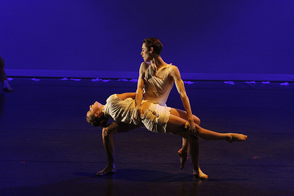 Two people in a dance performance.