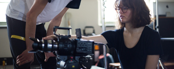 Film and TV short course students working with a camera.