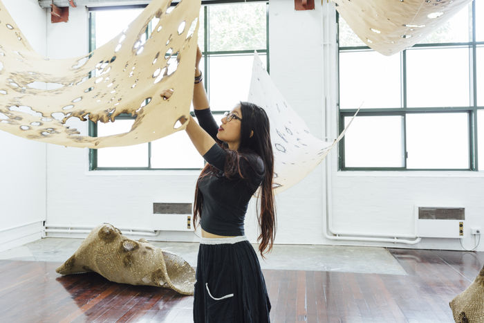 Yumemi Hiraki installing work at the 2015 Art Graduate Exhibition. Photo: Drew Echberg.
