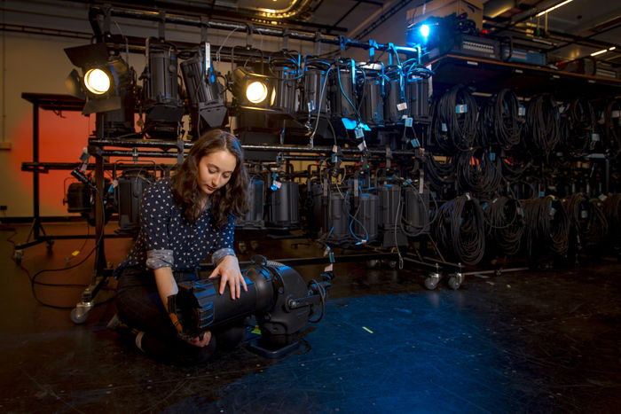 Production student Michelle Thorne working with a lighting rig backstage. Image: Sav Schulman, 2016.